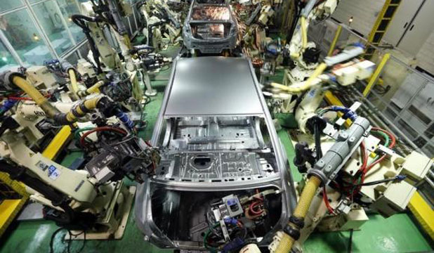 Asia's carmakers still welded to steel